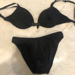 black shaped bikini with polka dot bow